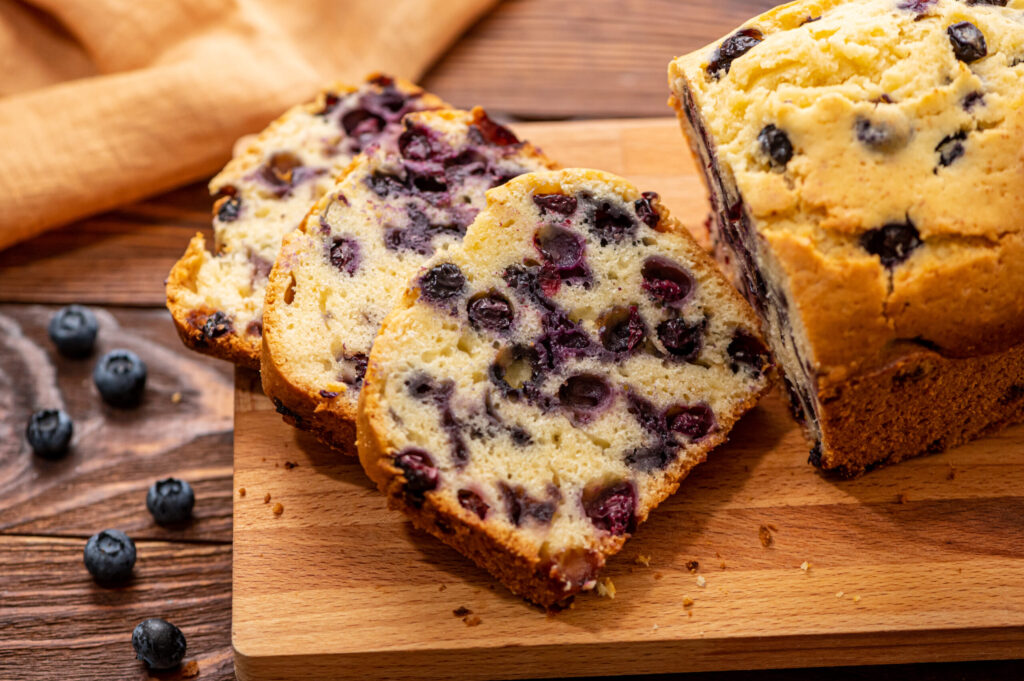 slices of moist quick bread with berries throughout