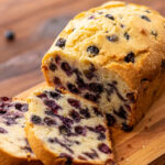 juicy blueberries throughout a vanilla flavored quick bread