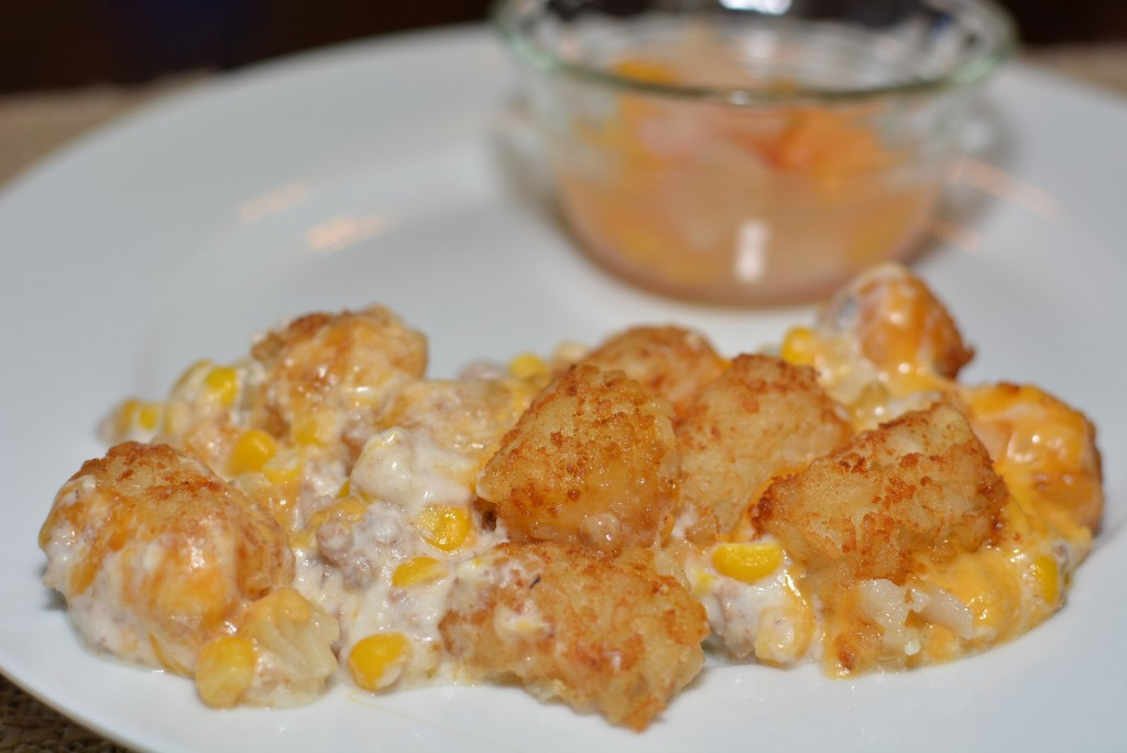 Warm and creamy tater tot casserole served on a plate.