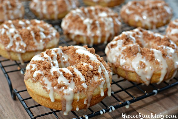 fluffy baked donuts with a cinnamon crumble and sweet glaze on top