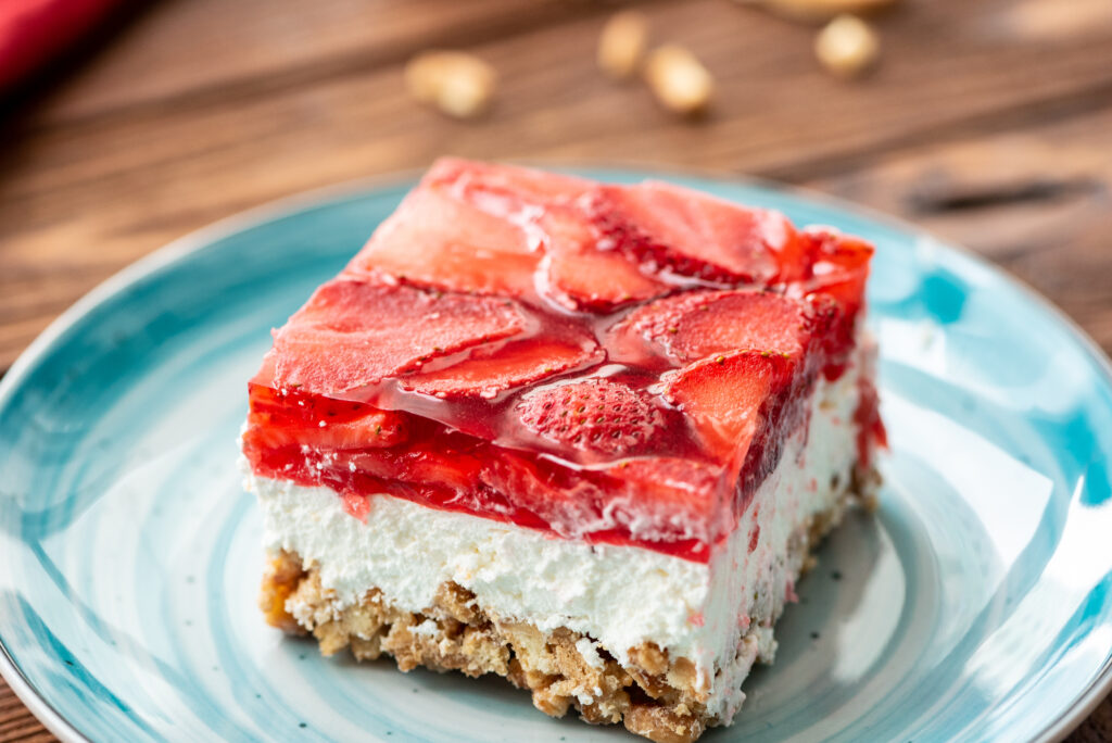 layers of pretzels, whipped topping, cream cheese, and strawberries combine into a flavorful dish