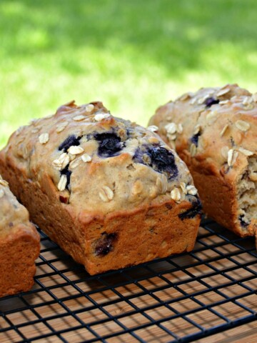 flavorful lemon bread with blueberries and oats throughout