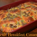 fluffy biscuits with cooked sausage and cheese in a flavorful casserole