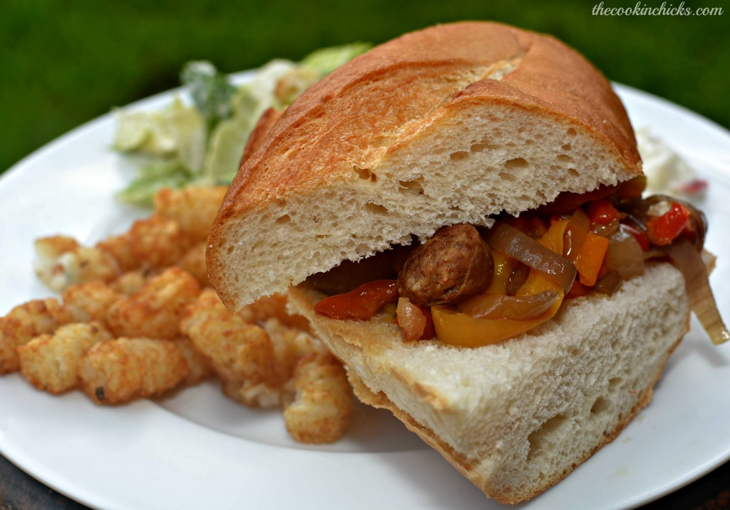 slow cooked Italian sausage with peppers and onions served on bread and enjoyed as a sandwich