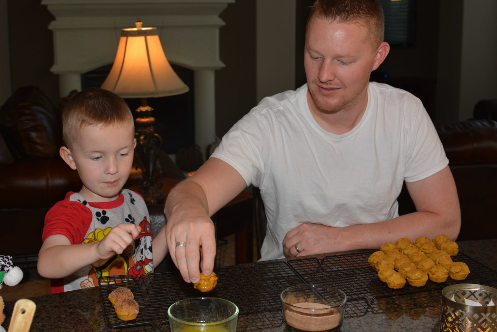 dipping the muffins into a tasty mixture