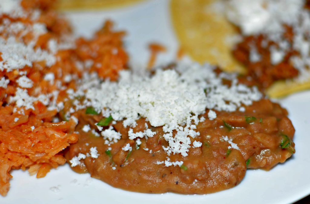 The Best refried beans topped with fresh cotija cheese