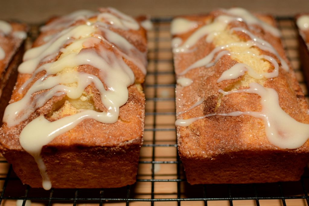 fluffy quick bread with cinnamon sugar throughout and a cream cheese frosting on top