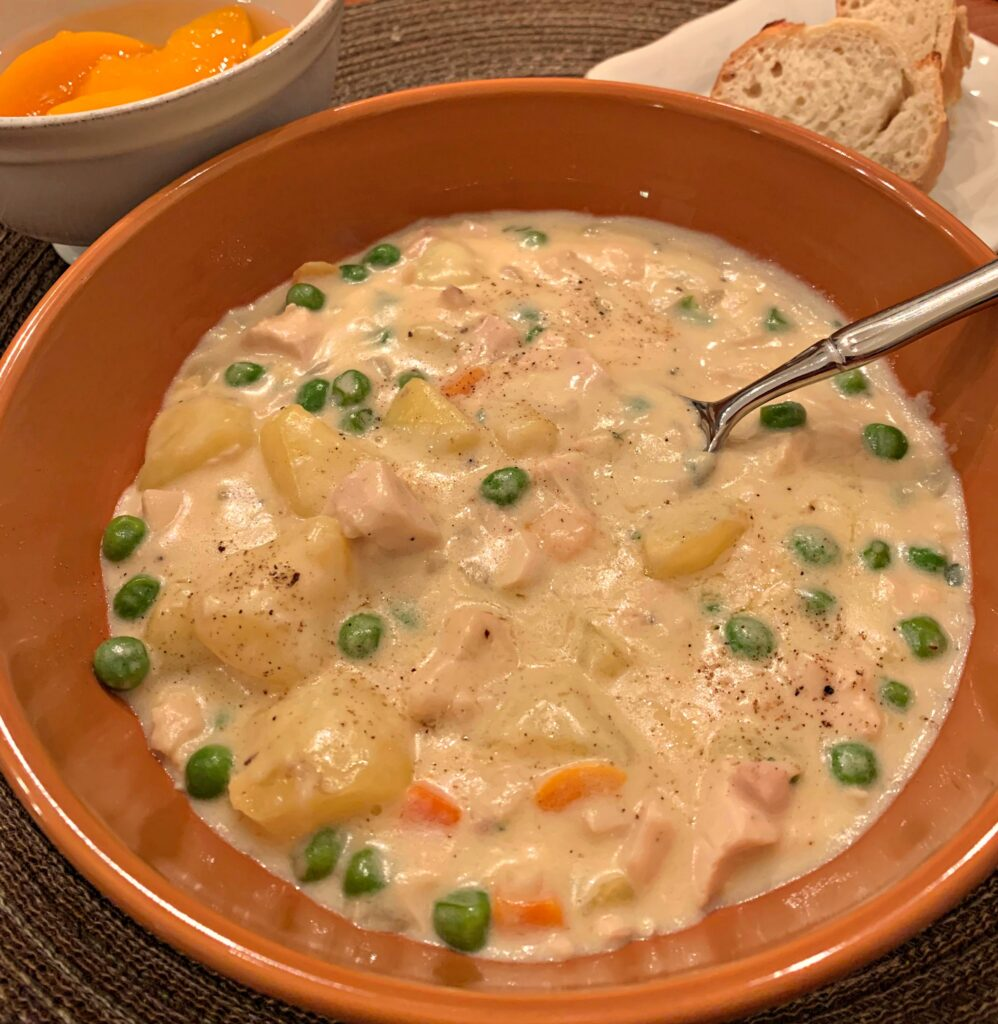creamy soup with tender chicken and veggies throughout