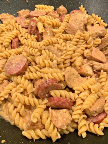 slices of smoked sausage, diced chicken, and tender pasta tossed in a creamy cajun sauce