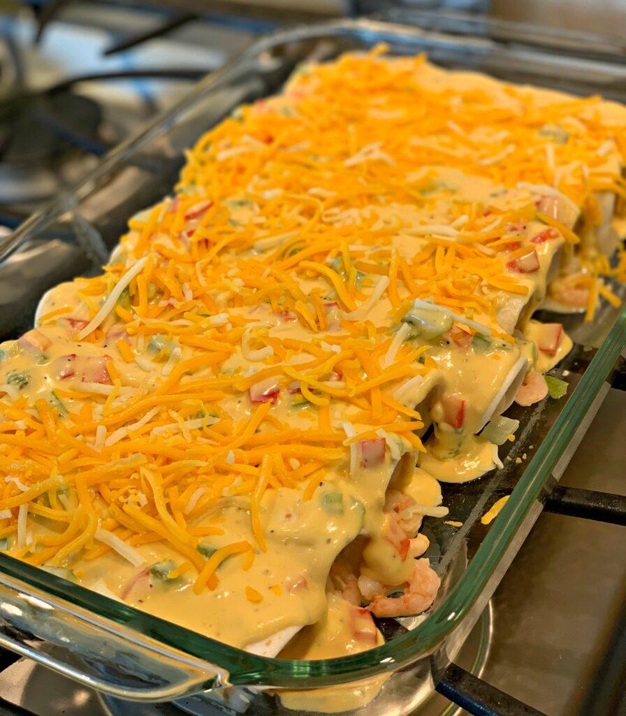 Tasty Shrimp Enchiladas covered in cheddar cheese!