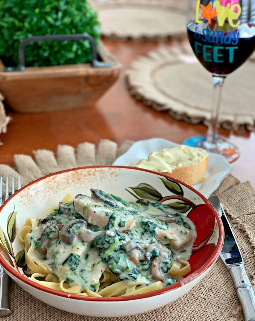 tender chicken and spinach tossed in a garlic parmesan cream sauce