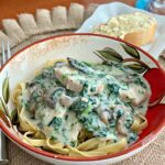 a creamy garlic parmesan sauce coating tender chicken and spinach, cooked in the instant pot