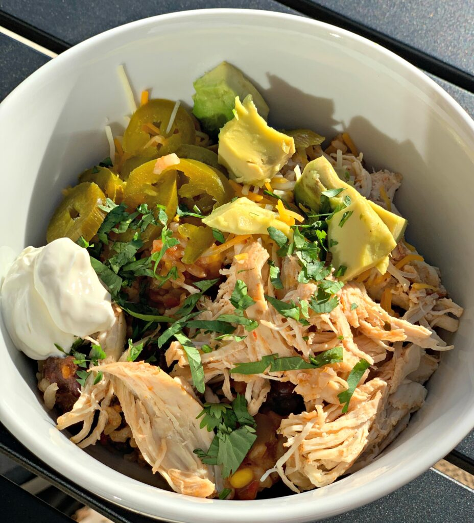 adding toppings of your choice to shredded chicken and rice made in the instant pot