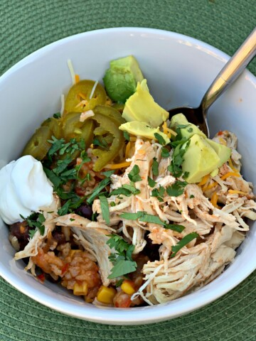 flavorful chicken and rice made in the instant pot and served with your favorite toppings