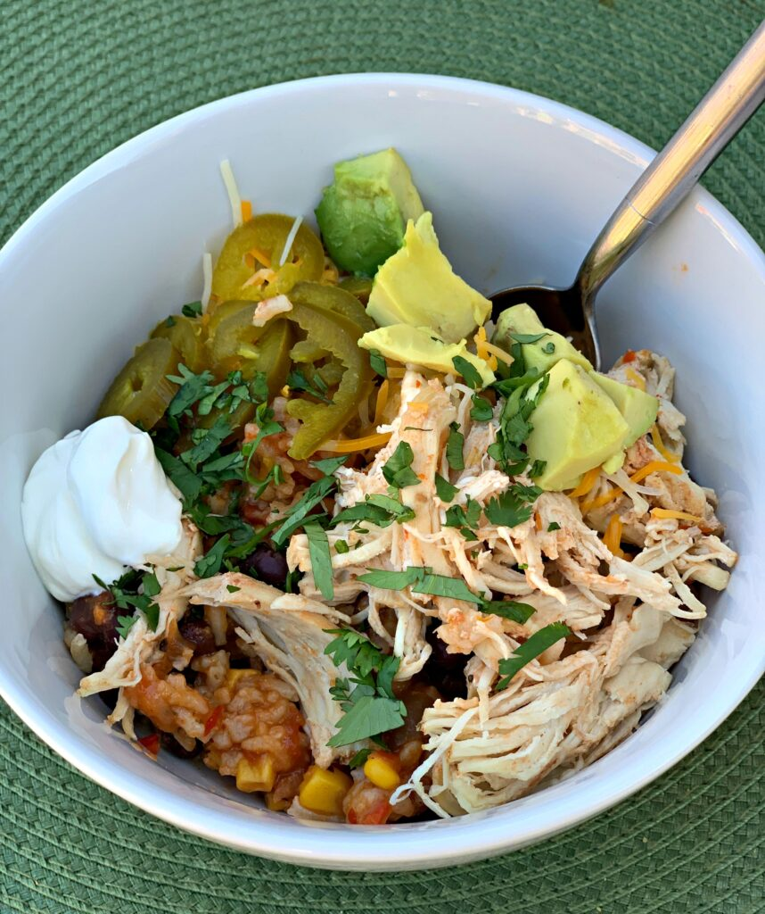 shredded chicken, rice, and toppings combined into a flavorful taco bowl