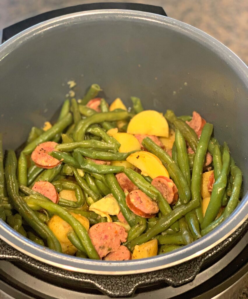 This recipe for Instant Pot sausage, green beans and potatoes is a quick one pot meal that's ready in just a few minutes