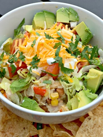 tender chicken, rice, beans, and corn cooked in the instant pot to create burrito bowls