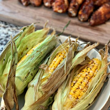 husks of tender sweet corn cooked on the smoker