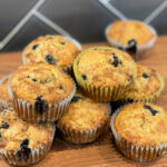 Stacked banana blueberry muffins fresh from the oven.