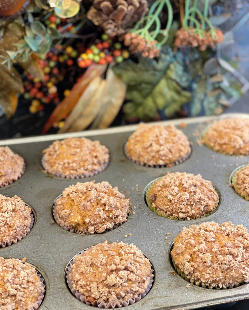 Cinnamon Streusel Pumpkin Muffins in a tray fresh from the oven.