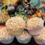 Fluffy, moist pumpkin muffins with a crumbled cinnamon streusel on top